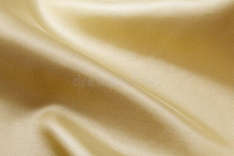 Fond en soie d'or photos libres de droits