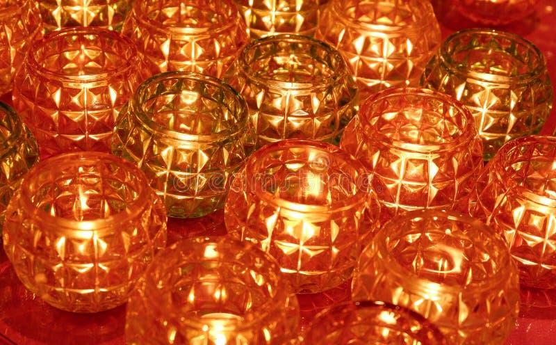 Fond en verre rouge et brun de modèle de pot de bougie photographie stock libre de droits