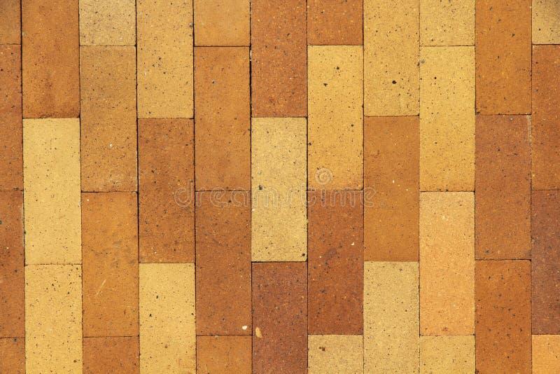 Fond et texture sans couture de carrelage de poterie de terre de Brown image stock