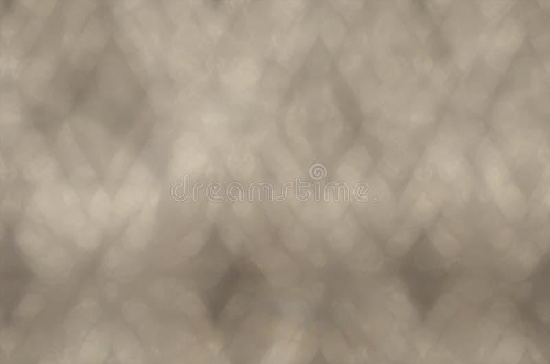 Fond foncé d'or de sépia avec Bokeh photographie stock
