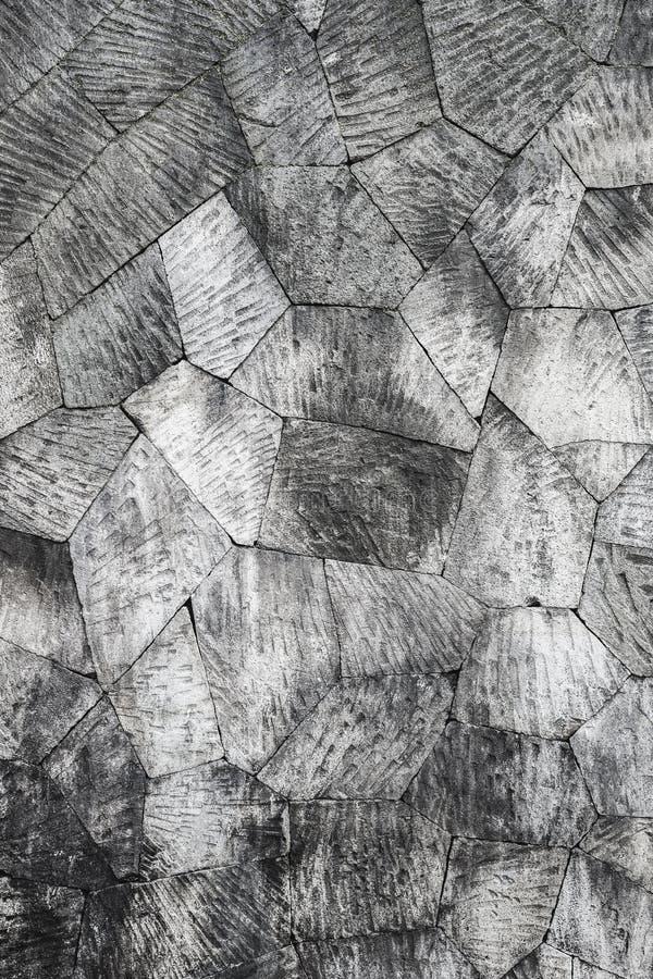 Fond gris de mur en pierre, modèle géométrique photographie stock