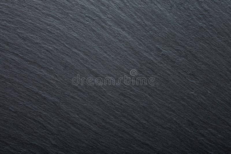 Fond gris-foncé et noir de granit d'ardoise Fond de texture pour votre projet photo stock