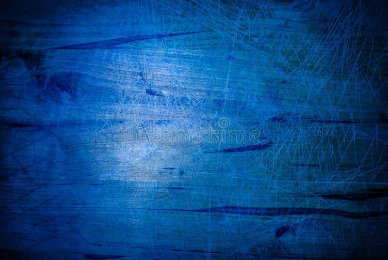 Fond grunge rougeoyant bleu de texture avec des grattoirs d'éraflures images stock