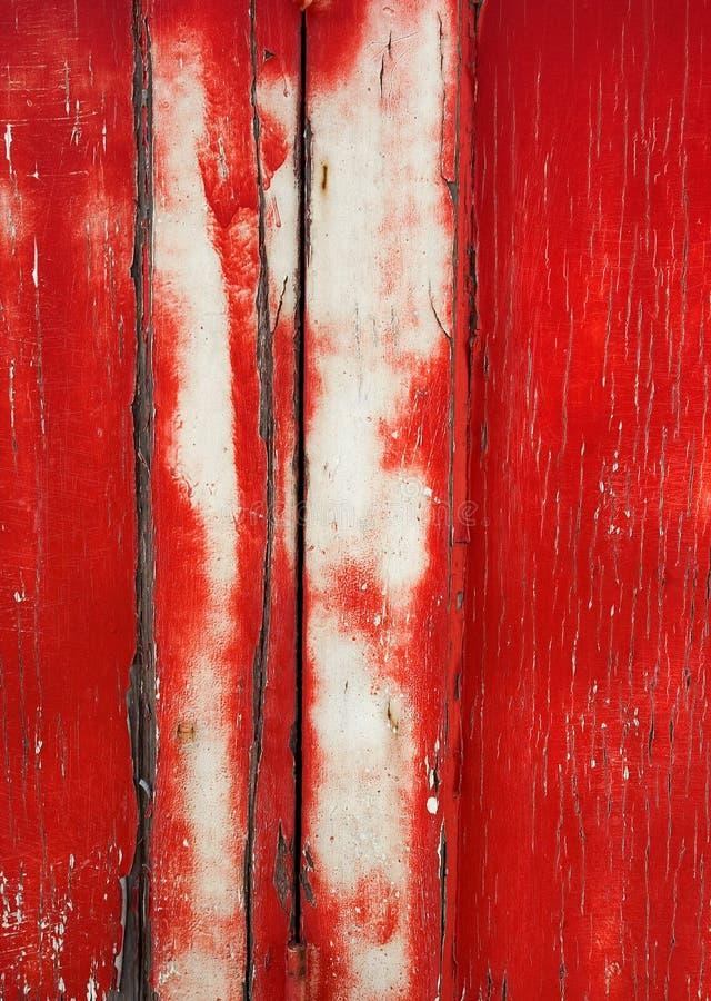 Fond grunge : Trappe rouge criquée photos stock