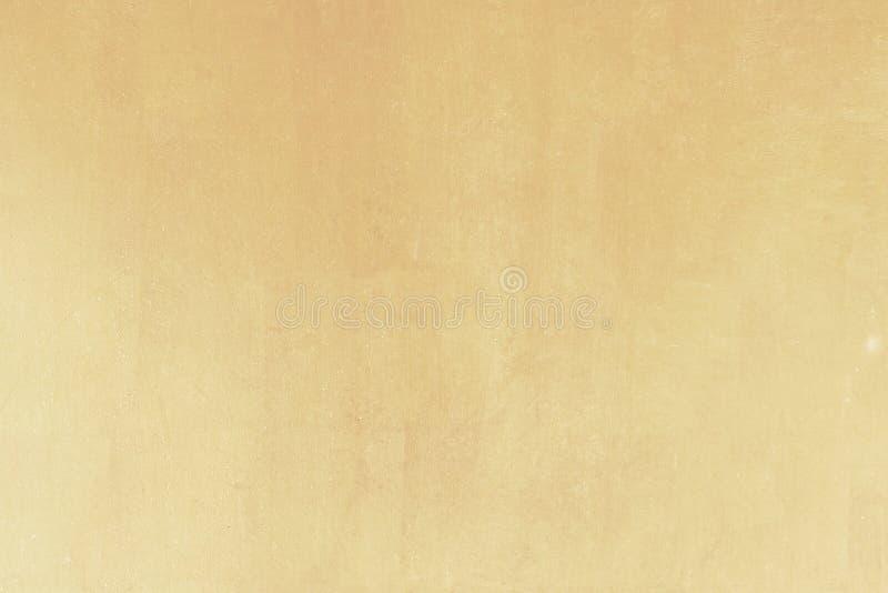Fond jaune brillant de texture de feuille d'or de feuille photo libre de droits