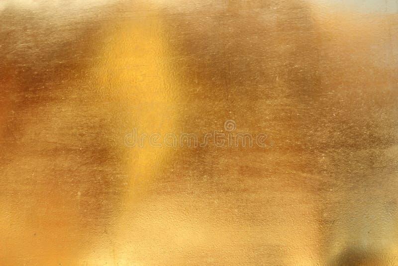 Fond jaune brillant de texture de feuille d'or de feuille images stock