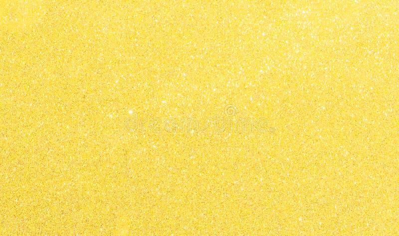 Fond jaune de scintillement de nouvelle année de Noël Tissu abstrait de texture de vacances Élément, éclair photo libre de droits