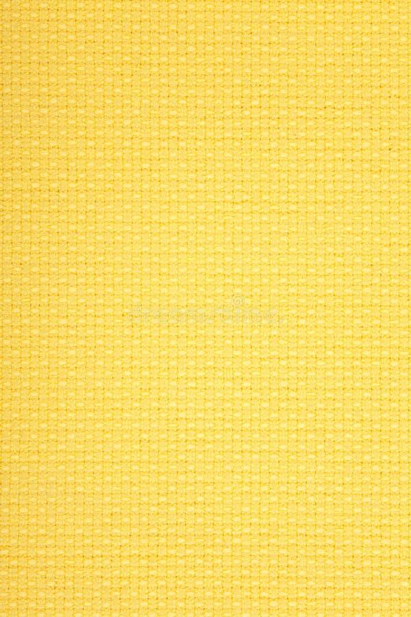 Fond jaune de toile images stock