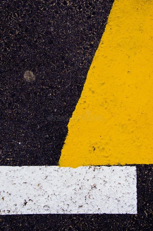 Fond jaune et noir et blanc d'asphalte image libre de droits