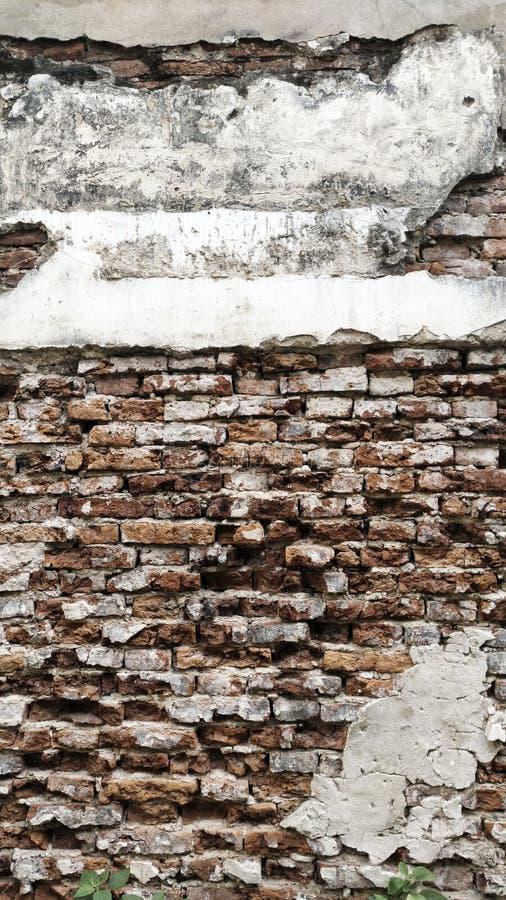Fond le vieux et de fente de mur de briques de texture image libre de droits