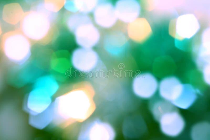 Fond lumineux brouillé de bokeh, vert, jaune, bleu, vacances, m photo stock