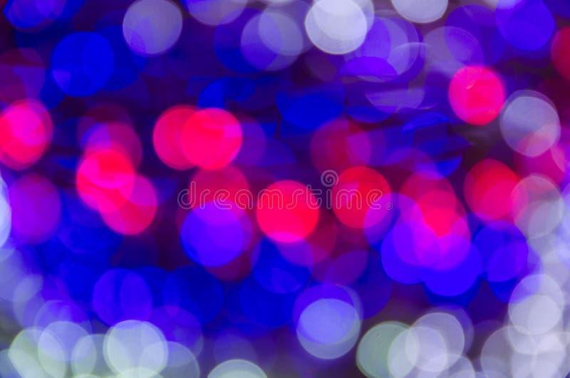 Fond lumineux coloré abstrait de bokeh de Christmaslight photographie stock libre de droits