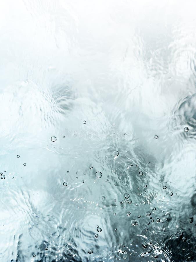 Fond méditatif d'écoulement de l'eau de vert bleu photo libre de droits