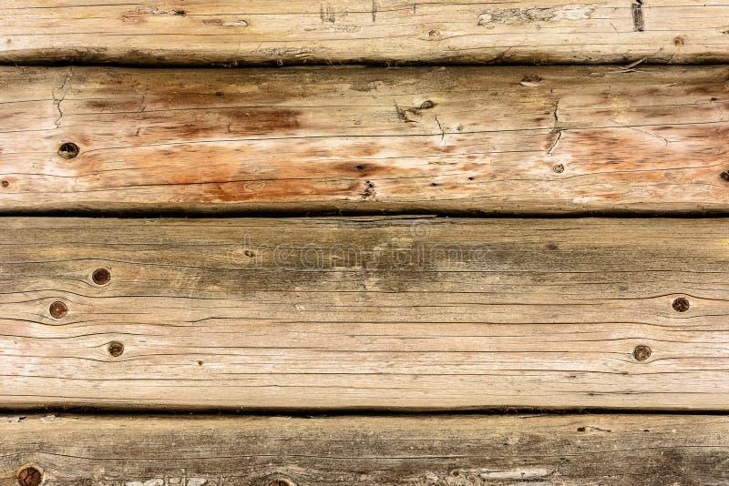 Fond magnifique d'un vieux mur texturisé fait de faisceaux en bois bruns photo stock