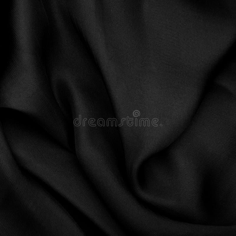 Fond matériel noir photo stock
