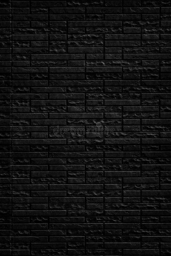 Fond noir abstrait de texture de mur de briques Vue verticale de mur de briques de maçonnerie images libres de droits