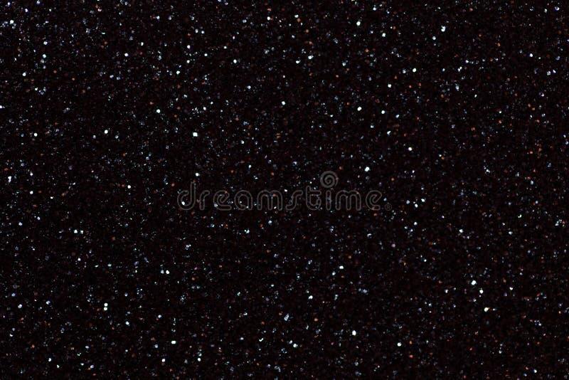 Fond noir brillant brouillé avec les lumières de scintillement photo libre de droits