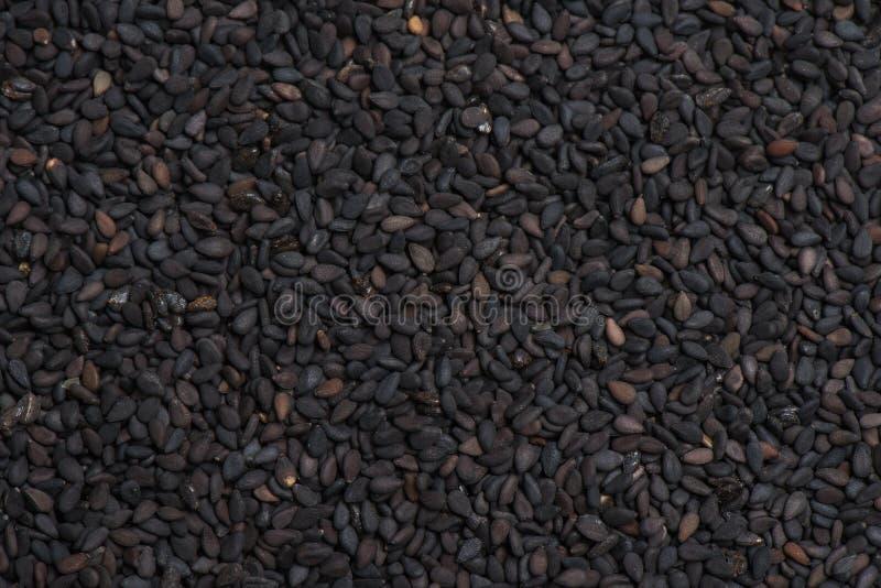 Fond noir de la graine de sésame photos libres de droits
