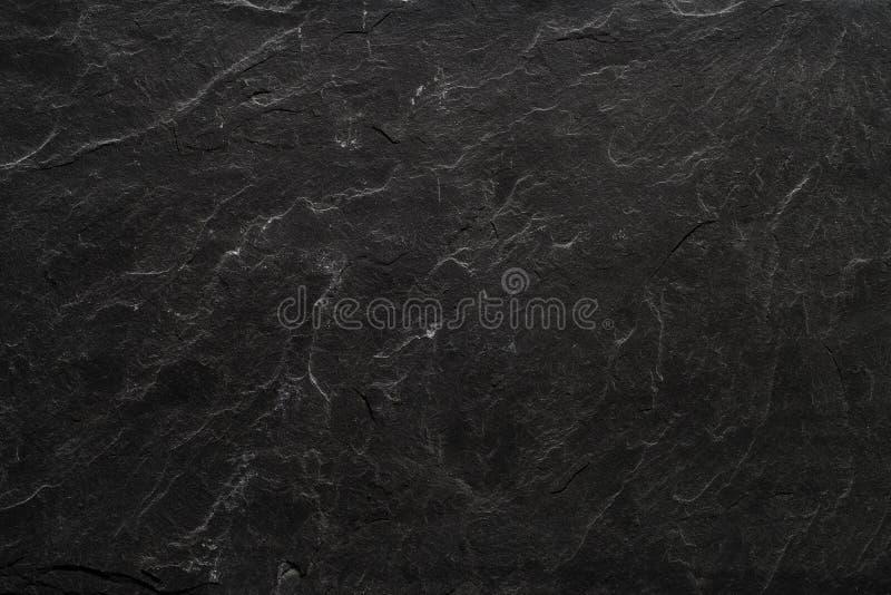 Fond noir de plat de pierre d'ardoise photo libre de droits