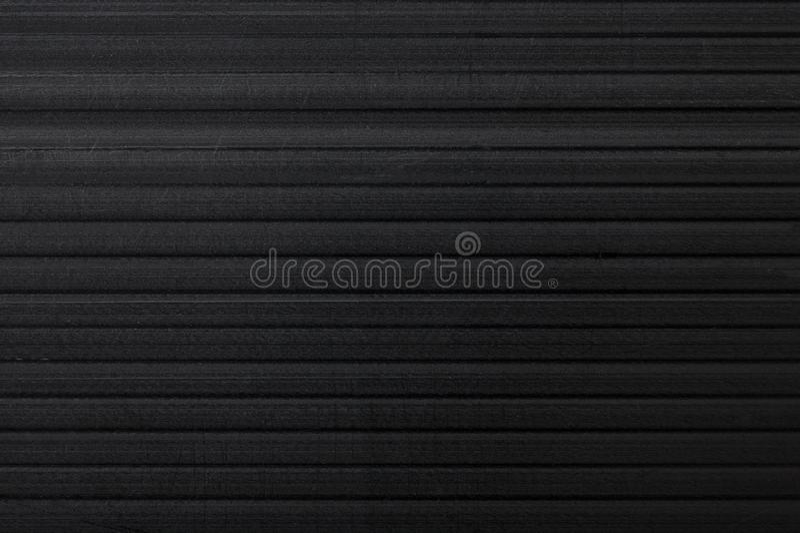 Fond noir de texture de panneau de cannelure Concept matériel et industriel Plastique de corriboard de plan rapproché photos stock