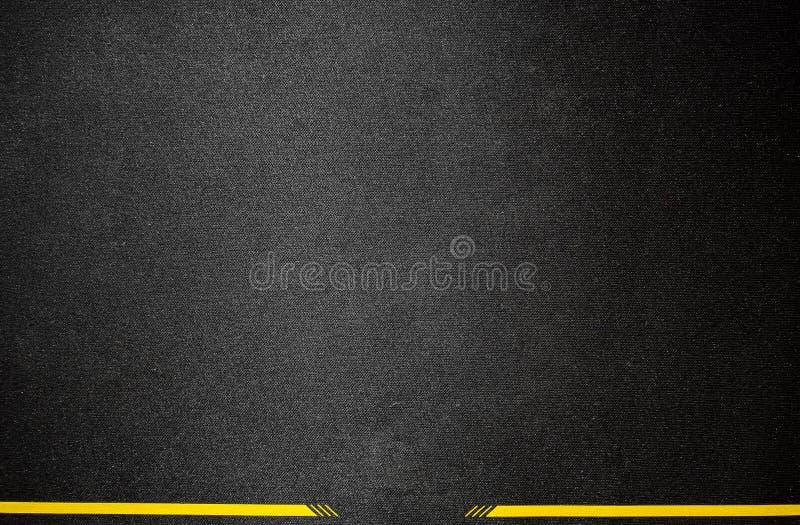Fond noir de tissu avec la rayure jaune photos libres de droits