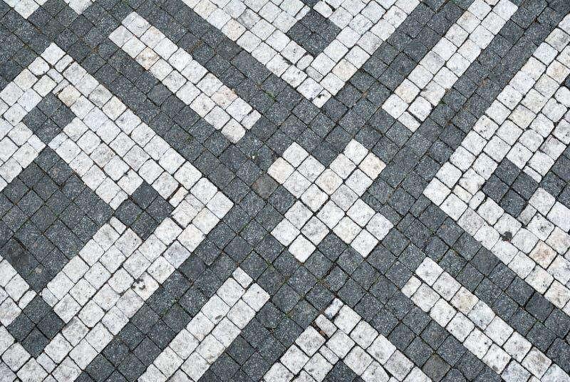 Fond noir et blanc de pavé rond photo stock