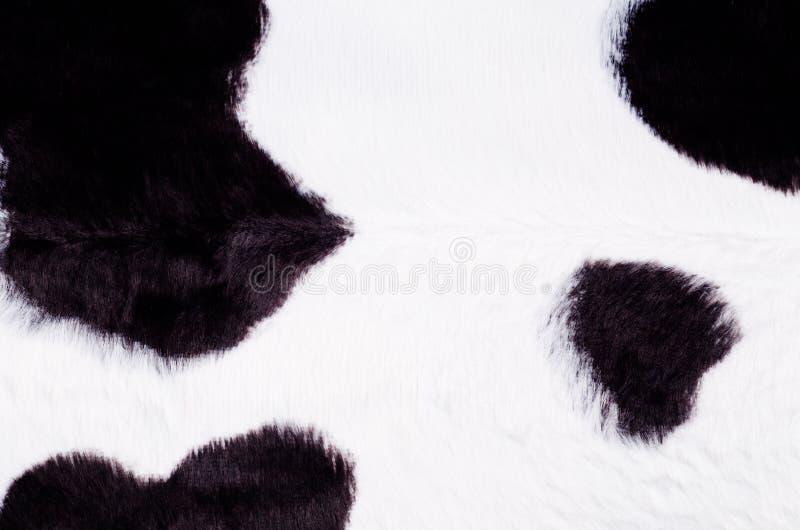 Fond noir et blanc de peau de vache image stock