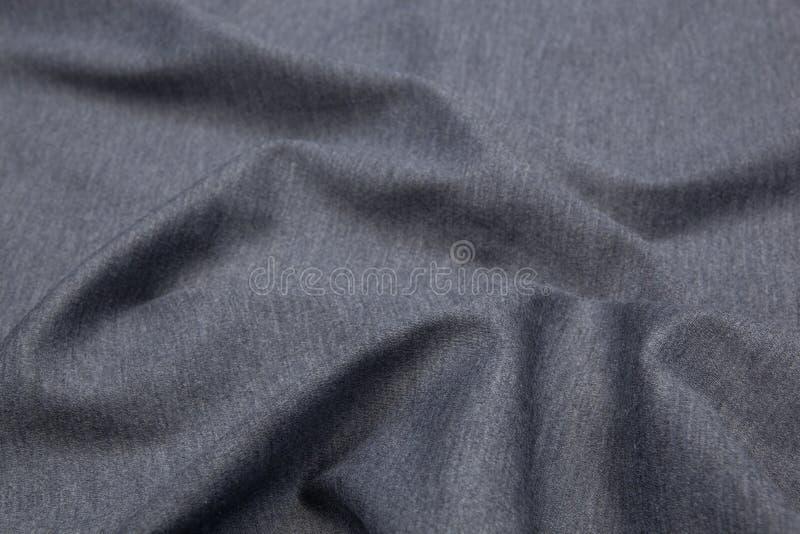 Fond onduleux de texture de plan rapproché de tissu image stock