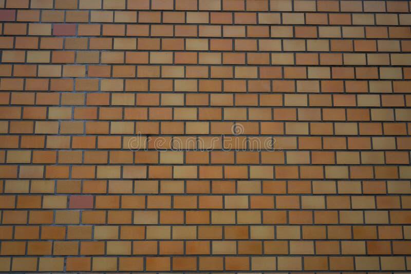 Fond orange de brique de mur au Japon images libres de droits