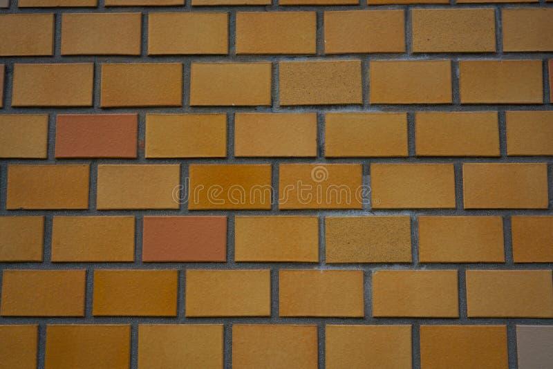 Fond orange de brique de mur au Japon image libre de droits