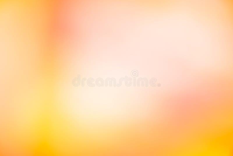 Fond orange de papier peint de couleur de tache floue de gradient abstrait de lumière photographie stock