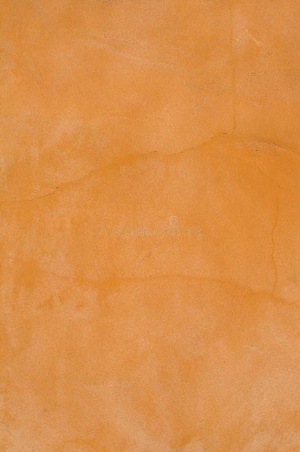 Fond orange et blanc de mur de terre cuite images stock