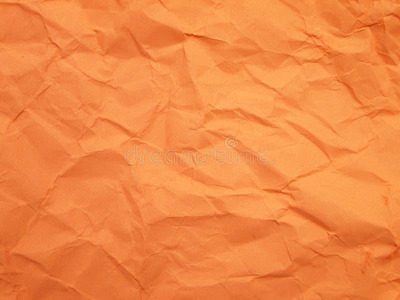 Fond orange - papier chiffonné image stock