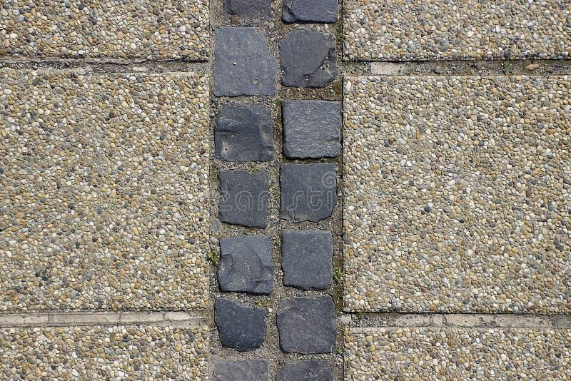 Fond ou texture de trottoir de pavé rond de bardeau de caillou photo stock
