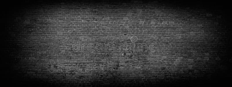 Fond panoramique de mur de briques noir photo libre de droits