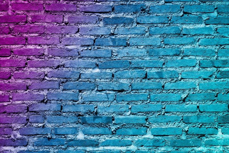 Fond peint coloré de texture de mur de briques Mur de briques de graffiti, fond coloré images stock