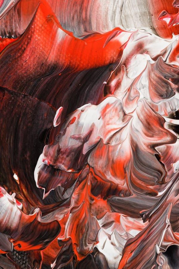Fond peint dans des tons en pastel du rouge et du noir photos libres de droits
