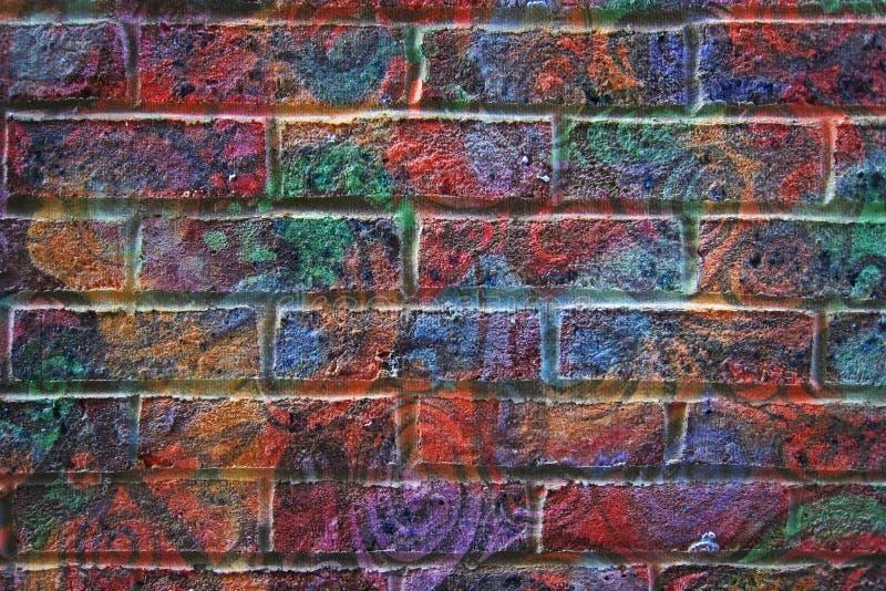 Fond peint psychédélique de mur de briques photographie stock