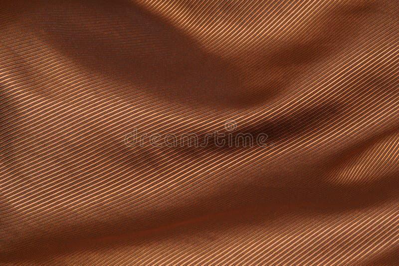 Fond plié par tissu d'or de velours photo stock