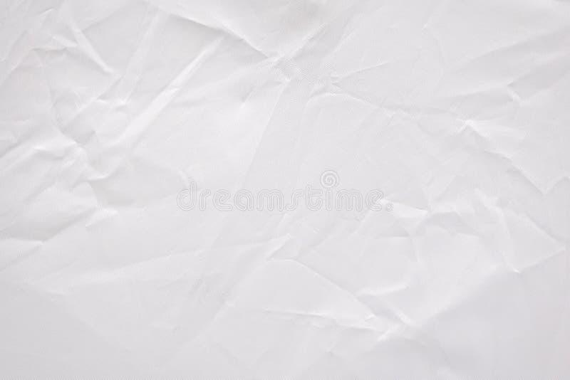 Fond plissé abstrait de texture de tissu Modèle blanc chiffonné de matériel de textile photographie stock