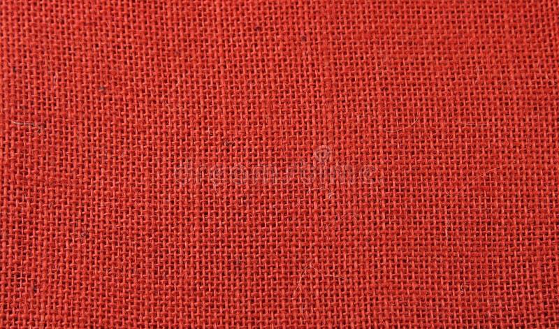 Fond rouge de jute images stock