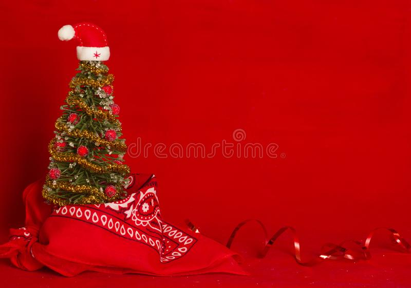 Fond rouge occidental de carte de Noël avec la bandanna de cowboy photo stock