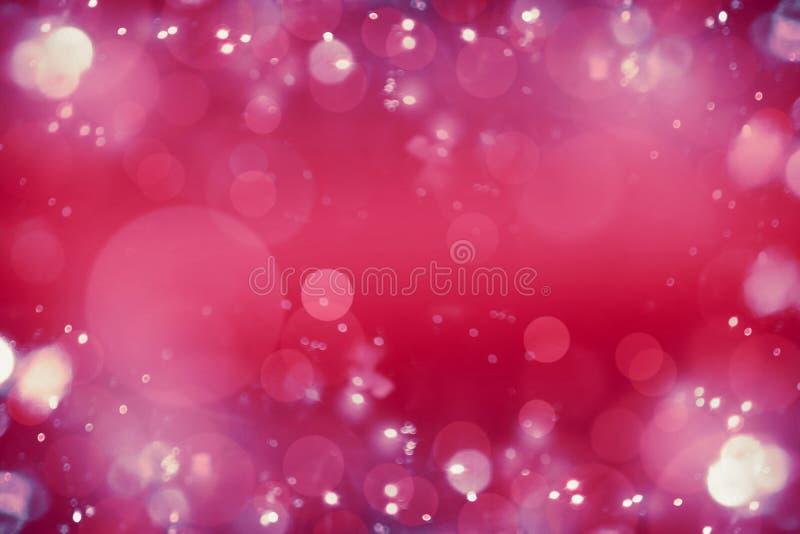Fond rouge-rose lumineux de bokeh Fond abstrait brouillé de vacances ou d'événement photo libre de droits