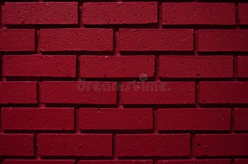 Fond rouge sang profond de mur de briques de couleur image libre de droits