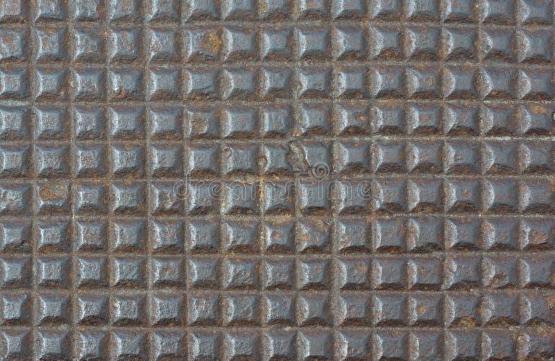 Fond rouillé de brun de texture de modèle de place en métal image stock