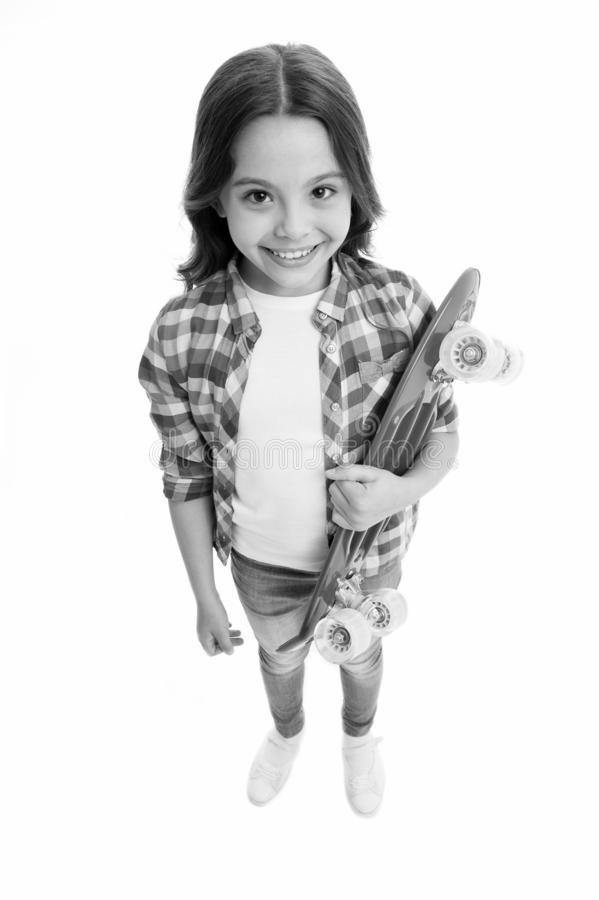 Fond of skateboarding. Kid girl happy carries penny board. Child likes skateboarding with penny board. Modern teen hobby. How to ride skateboard. Girl happy stock images
