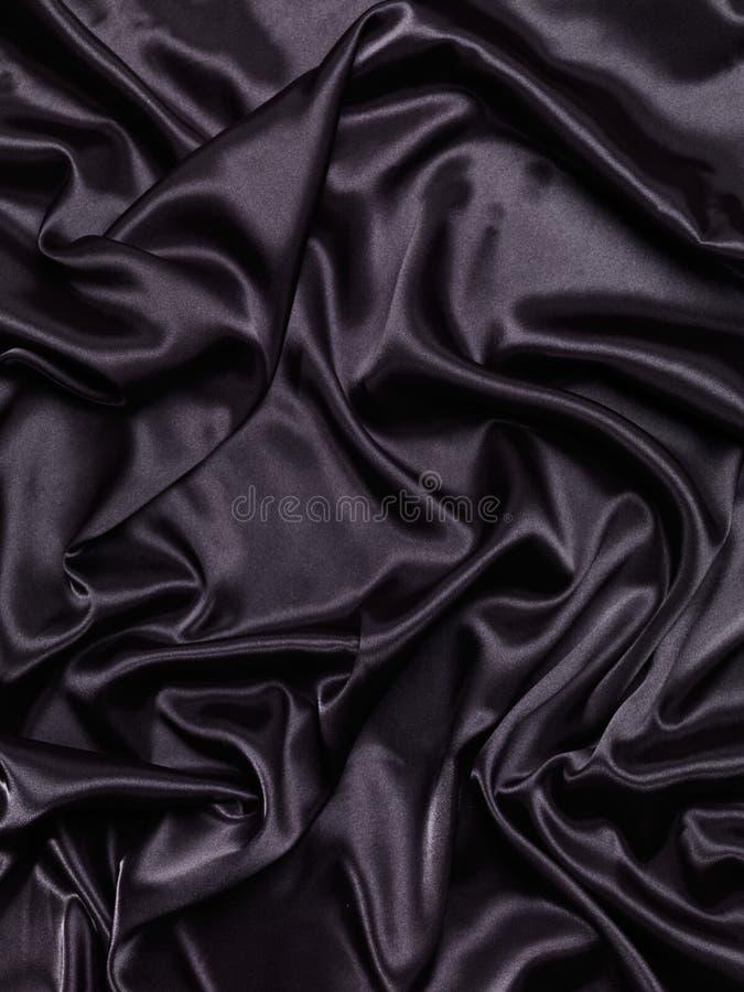 Fond soyeux brillant noir d'abrégé sur tissu photographie stock