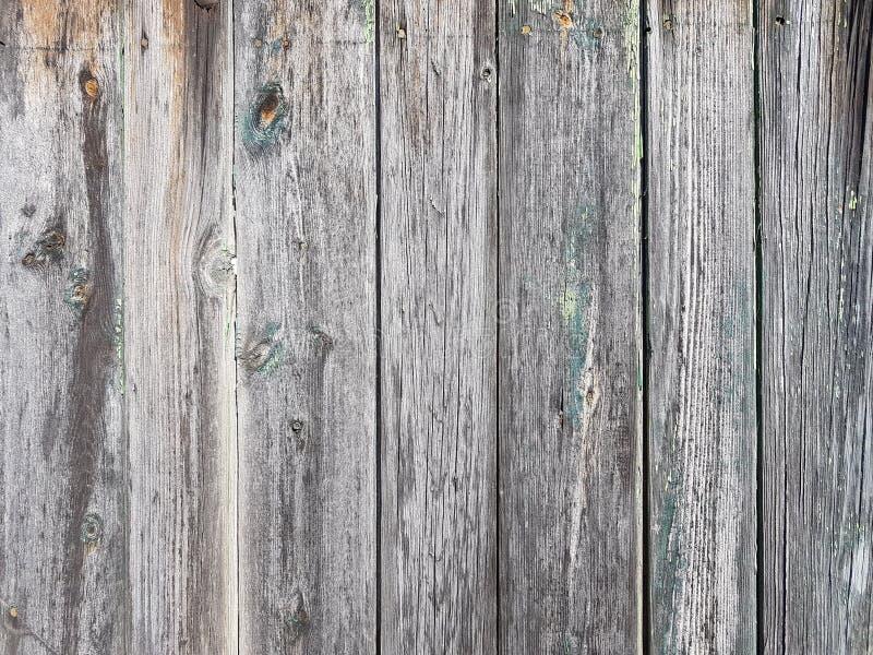 Fond superficiel par les agents gris de vieille de barrière de planche architecture extérieure en bois de l'Europe image libre de droits