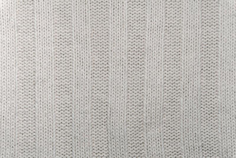 Fond, texture - surface d'une fin de tissu tricotée par laine  image libre de droits