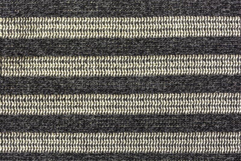 Fond, texture, tissu avec les rayures horizontales du noir et images libres de droits